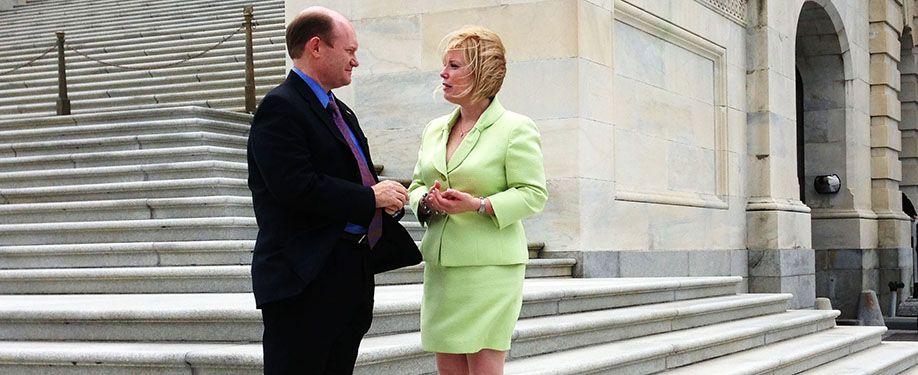 Delaware Senator Nicole Poore with U.S. Senator Chris Coons